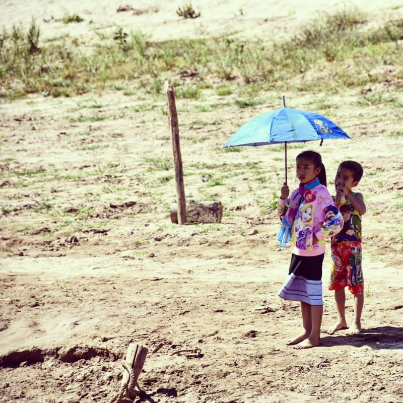 Children at the Mekong river, Laos