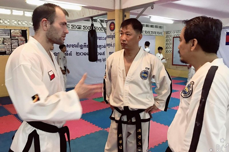 Discussion with Masters Keo Remy and Ri Chol Nam before the training starts